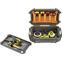 a green Pelican R60 ruck case, open with the divider tray removed, containing a variety of small hand tools
